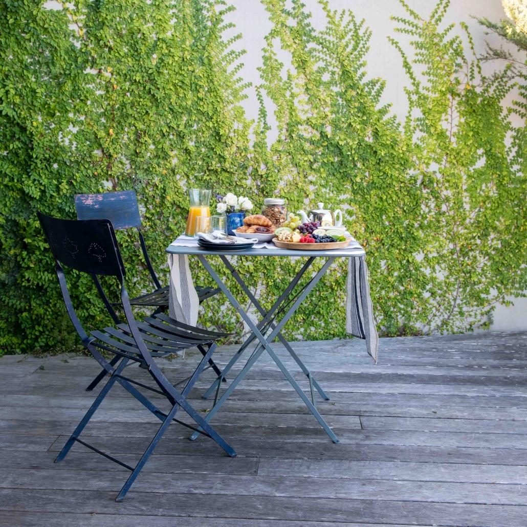Beautiful breakfast on the deck of luxury accommodation blue room Waiheke Island