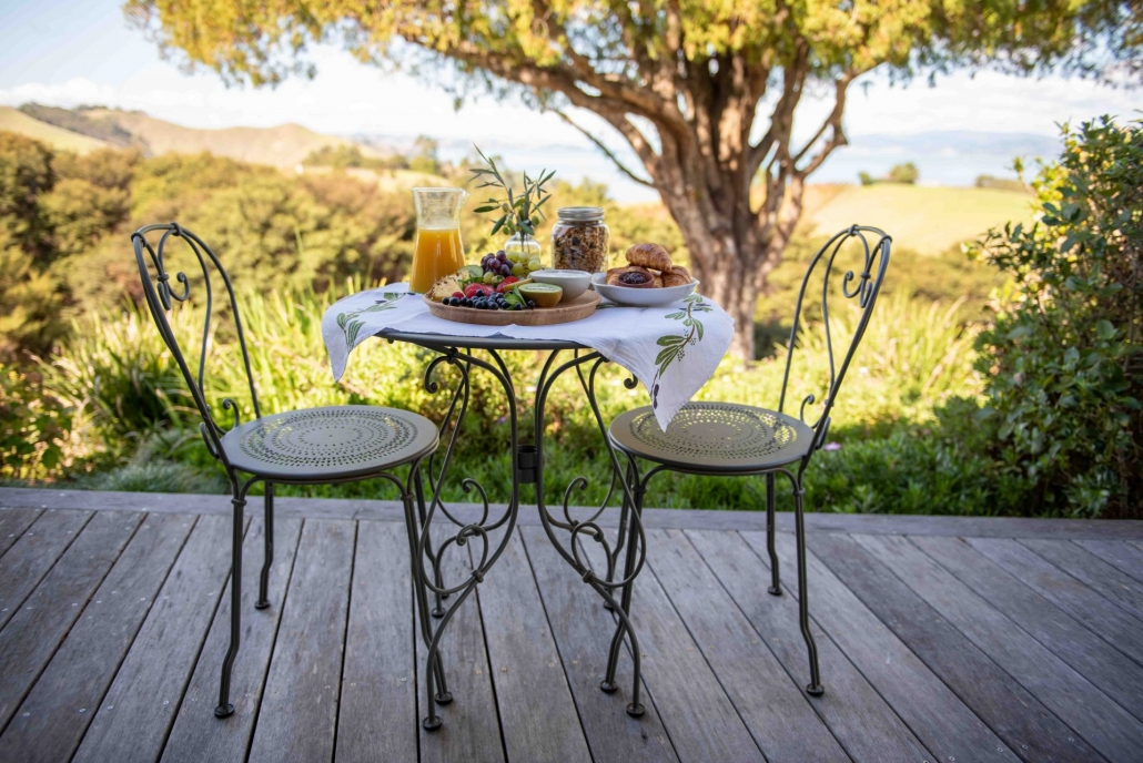 Beautiful breakfast on the deck of luxury accommodation green room Waiheke Island