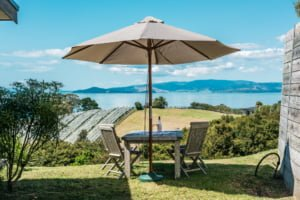 Wine and deck chairs with umbrella