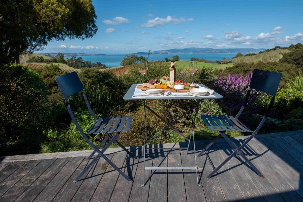 Platter and wine on the deck of luxury accommodation blue room Waiheke Island